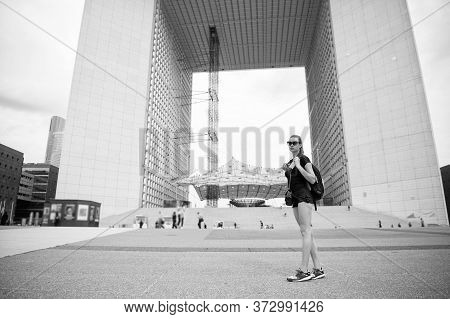 Sightseeing Guide. Girl Tourist Sunglasses Enjoy City Center Square. Woman Stand In Front Of Urban A