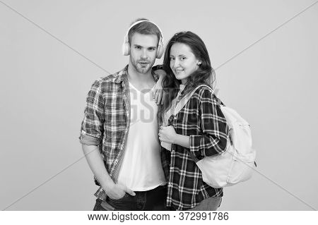 Youth Lead Way In Fashion Ideas. Hipster Couple Students. Fashionable Students Couple Yellow Backgro