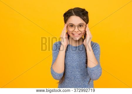 Eye Accessory Sure To Please. Happy Girl Wear Glasses Yellow Background. Fashion Accessory. Designer