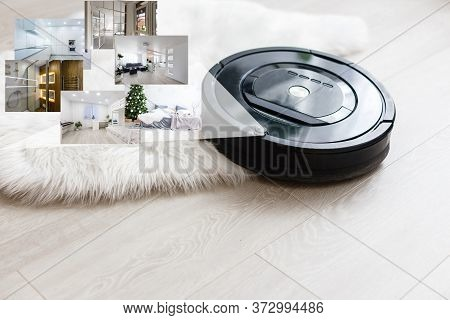 Robotic Vacuum Cleaner On Laminate Wood Floor Smart Cleaning Technology. Photo