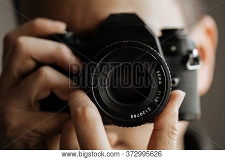 Man Taking A Picture On A Pentax Film Camera. Close Up