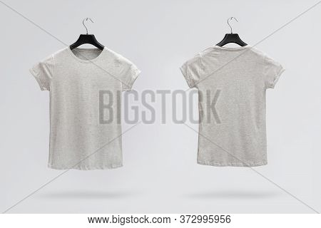 Front And Back Sides Of Female Grey Melange Cotton T-shirt On A Hanger Isolated On A White Backgroun