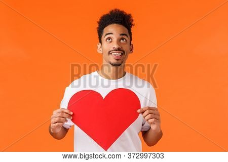 Dreamy And Romantic African-american Boyfriend Feeling Inspired And Excited, Holding Valentines Card