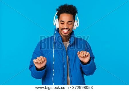 Guy Catching Positive Vibes, Feeling Groovie And Satisfied With New Headphones. Cheerful African Ame