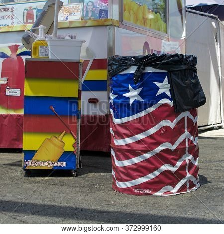 Sacramento, California, U.s.a. 23 July 2017. Trash Can Wrapped In The American Flag. The Fair Is Ann
