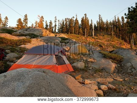 Sunset On Tent Set In T He Sierra Nevada Near Island Lake, California, Featuring The Rugged Terrain