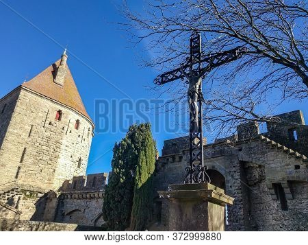 Carcassonne, France / 11.20.2017: A Metal Cross With A Crucifix On The Main Square Of Carcassonne Ag