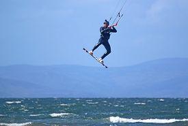 Kitesurfer Jumping Off Barassie Beach,  Troon, Scotland