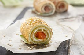 Homemade Pancakes Rolls With Soft Cheese And Salmon.