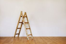 Wooden Ladder In An Empty Loft Style Room With Space For Text. Realistic Blank For Interior Design.