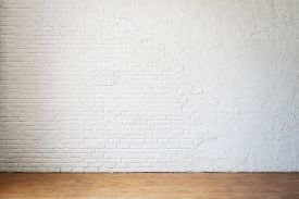Empty Room Without Furniture With A White Brick Wall And Wooden Floor. Realistic Blank For Interior