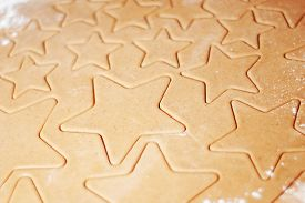 Star-shaped Gingerbread Cookie With Flour. Christmas Dessert. The Process Of Baking Cookies. Gingerb