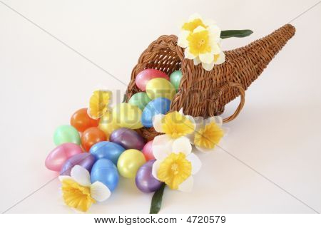 Easter Cornucopia With Eggs And Daffodils.