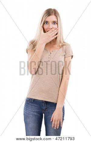 Beautiful blonde woman astonished with something with her hand in front of the mouth, isolated over white background
