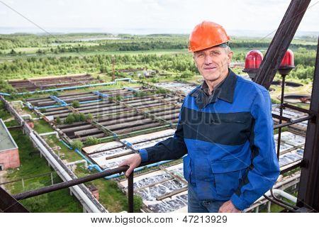 Smiling Caucasian Worker Standing For High Altitude Platform. Copyspace