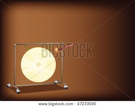 A Musical Gong On Dark Brown Background
