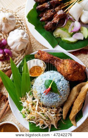 Nasi kerabu, popular Malaysian Malay rice dish. Traditional east coast blue rice. Famous in states such as Terengganu or Kelantan . Malaysia food, Asian cuisine.