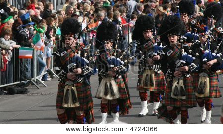 Irishmen In His Kilst Is Playing On Bagpipe During The St. Patrick's Day Parade March 16, 2009