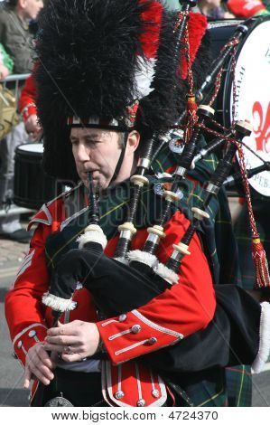 Irishmens In Them Kilst Are Playing On Bagpipe During The St. Patrick's Day Parade Held March 16, 20