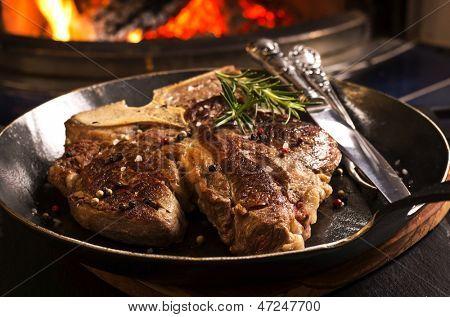 t-bone steak in the pan