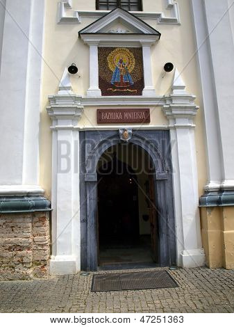entrance to the historic church of St Anne's Basilica and Shrine of Our Lady of Koden along the Bug River in Poland poster