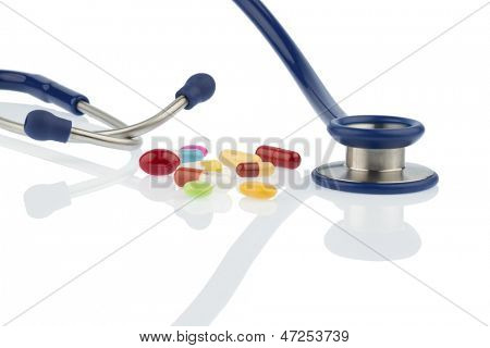 colorful pills and stethoscope, symbol photo for diagnostics, heart disease and interactions