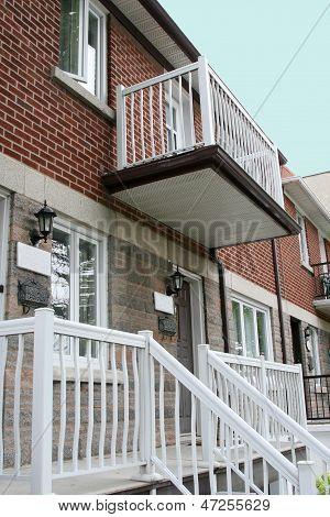 Attached duplex housing