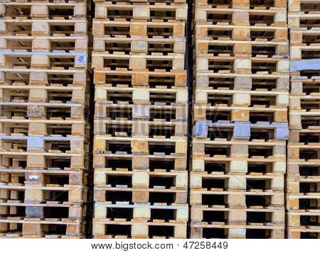 stacked pallets, symbolic photo for freight transport and logistics
