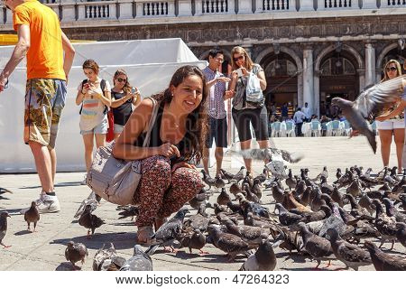 Italy, Venice - July 2012: Woman With Pigeons On Most Famous Square July 16, 2012 In Venice. More Th