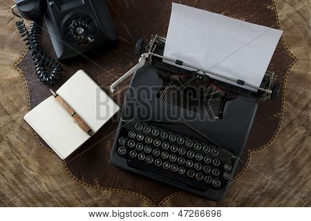 Typewriter on Desk with Phone and Notepad