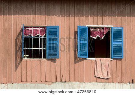 house with two open windows
