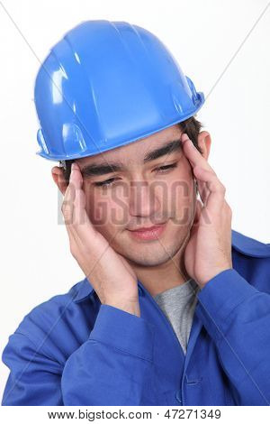 Builder suffering from tension headache