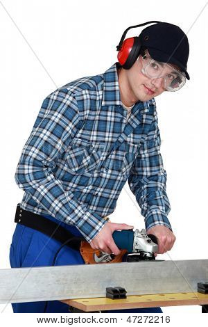 Young man using hacksaw
