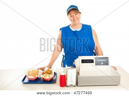 Friendly fast food worker serves food and runs the cash register.  White background.
