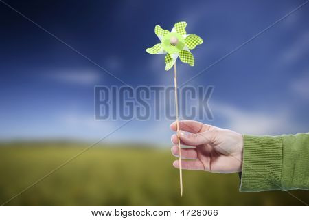 Young Woman Holding Pinwheel Windmill Outdoors