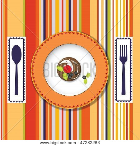 A plate with a cake on the bright background with a spoon and fork