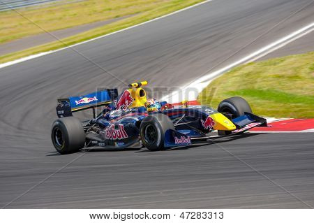 MOSCOW - JUNE 23: David Marshall Coulthard makes a show on a Formula 1 Red Bull Infiniti car at World Series by Renault in Moscow Raceway on June 23, 2013 in Moscow