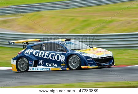 MOSCOW - JUNE 23: Mike Verschuur of Equipe Verschuur team race at Megane Trophy V6 race at World Series by Renault in Moscow Raceway on June 23, 2013 in Moscow
