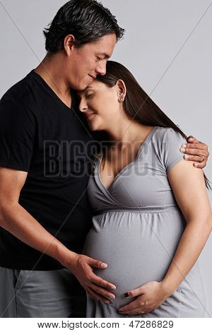 Young pregnant happy couple