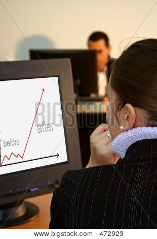 Businesswoman & Businessman - Working At Pc