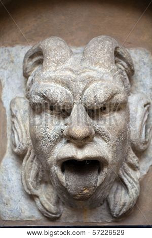 mascaron ornament with sourse of water in collegium maius in cracow