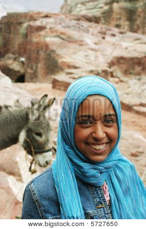 Young woman in blue head scarf and donkey,  Petra, Jordan, December 28, 2006
