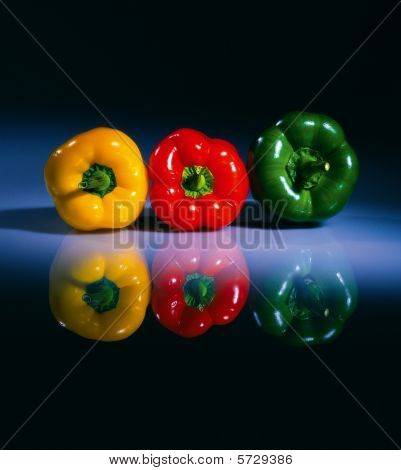 Three Colored Pepers On A Table