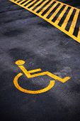 Disabled person parking place permit mark traffic symbol on the asphalt road poster
