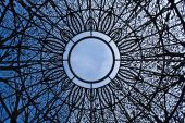 Sky View through ornamental wrought iron ornamental dome poster