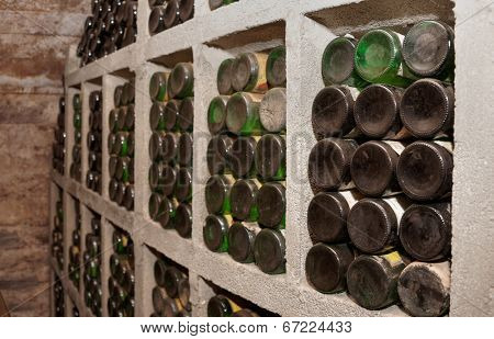 Cellar with old riesling wine bottles, labels erased or modified