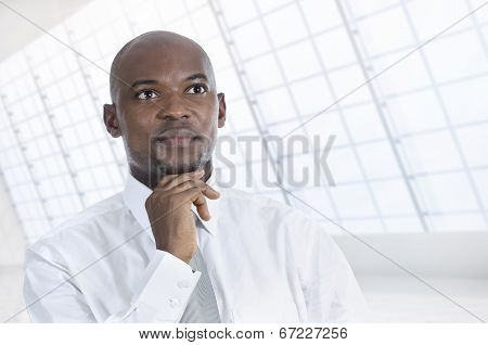 African Business Man Thinking In Office