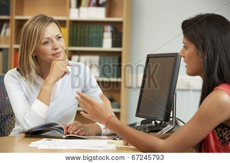 College tutor with student