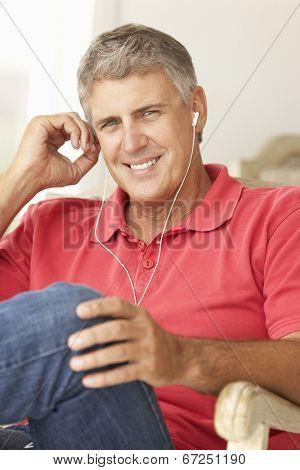 Mid age man wearing earphones