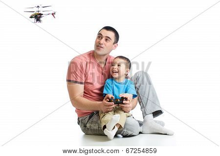 Father And Son Playing With Rc Helicopter Toy
